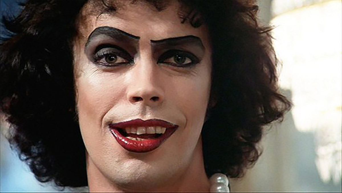 An image of Dr. Frank N Furter from Rocky Horror Picture Show (Tim Curry with heavy makeup and bold lipstick